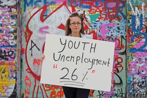 "Girl holding sign ""Youth unemployment"""