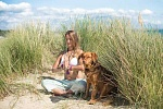 Meditating on a beach, with a dog