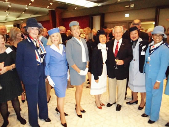 "Max Gurney with Pan Am ""girls"" wearing various styles of Pan Am uniforms throughout the years of operation."